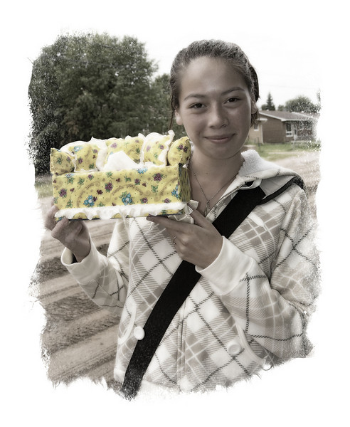 Paige Wong of Moosonee displays a tissue box holder she constructed in the shape of a sofa.