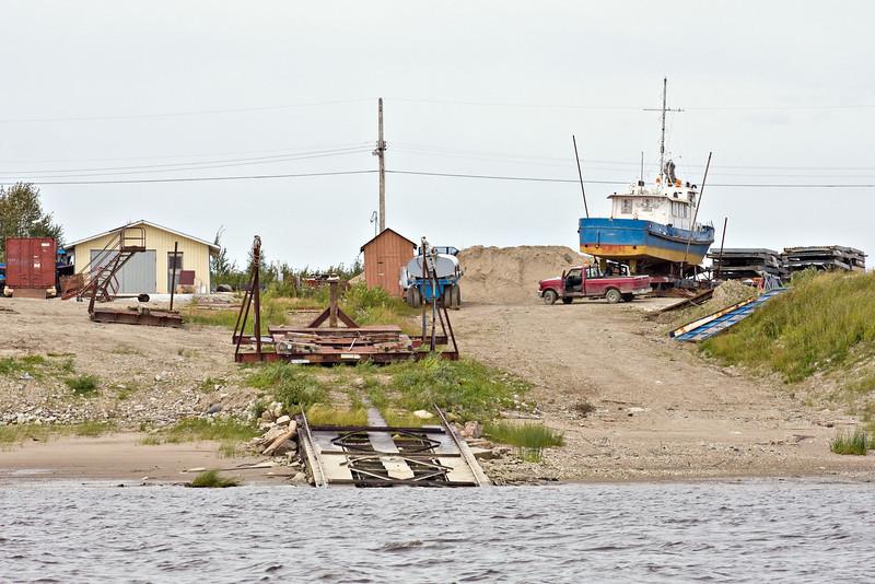 Marine railway and launching cradle for tug boats.