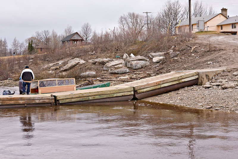 Public docks and ice remaining from spring breakup in Moosonee, Ontario