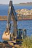 Moosonee Shoreline Stabilization - excavator working along river's edge placing fill.