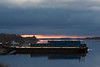 Barges anchored at Moosonee just after a cloudy sunrise