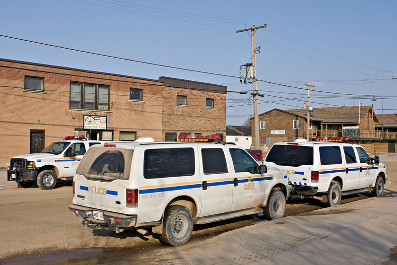Three Ontario Provincial Police vehicles on First Street in Moosonee. White SUVs.