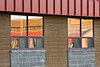 Reflections of Northern Lights Secondary School in windows of school board offices.