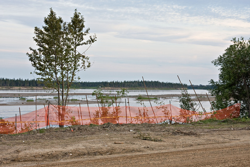 Looking across the Moose River from Moosonee with shoreline stablization project work in the foreground.