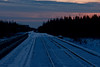 Sunset 2008 December 14 in Moosonee looking down the tracks towards Cochrane