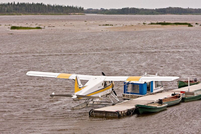 DHC-2 Beaver C-FDPM operated by Hearst Air docked at Two Bay docks in Moosonee, Ontario on the Moose River.