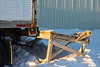 Damaged platform behind storage trailer at Northern in Moosonee.