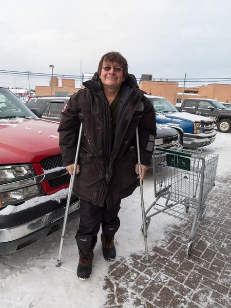Sam Hunter on crutches outside Northern Store in Moosonee.