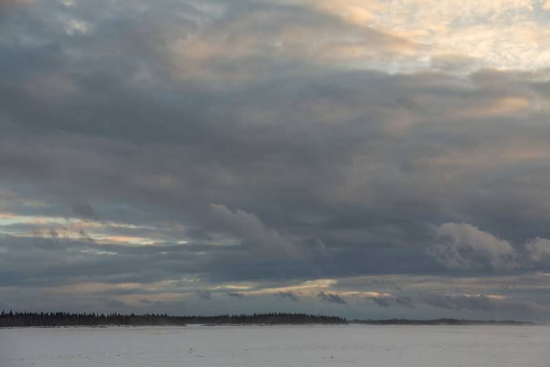 Looking up the Moose River from Moosonee. Blowing snow and fast clouds.