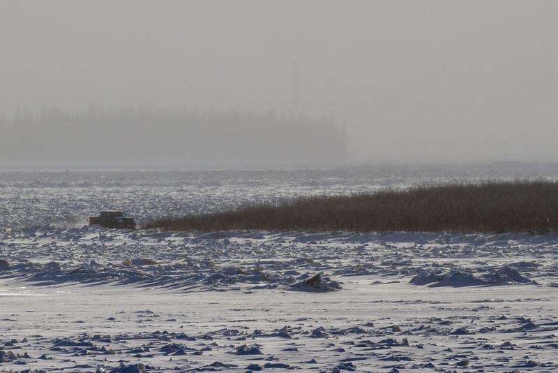 Truck on the Moose River headed to Moosonee, Ontario.