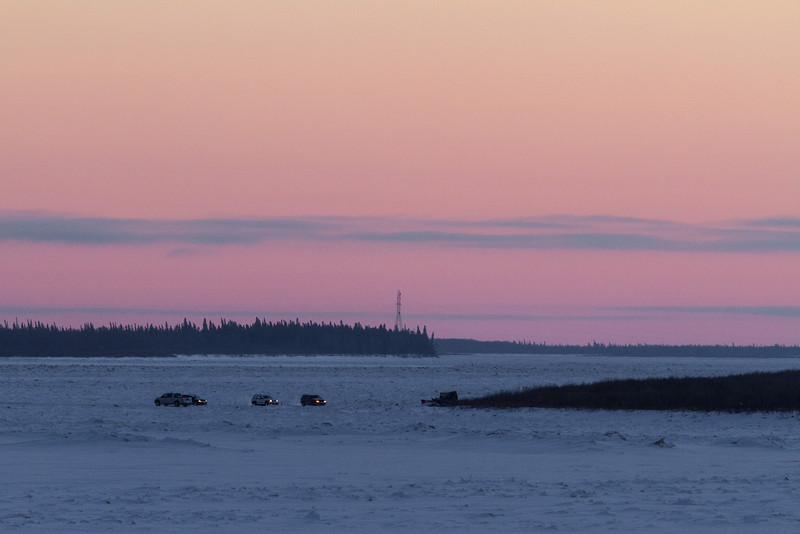 Traffic on the winter road across the Moose River coming from Moose Factory to Moosonee.