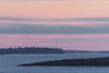 Looking up the Moose River from Moosonee towards hydro towers around sunset.