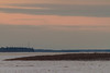 Looking up the Moose River from Moosonee towards hydro towers around sunrise.