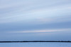 Looking across the Moose River from Moosonee just after sunrise. Cloudy.