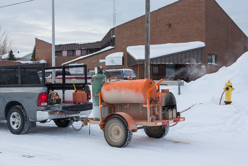 Thawing out a fire hydrant in Moosonee.