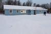 Joe Wesley shoveling snow outside Keewaytinok Native Legal Services 2013 December 6th.
