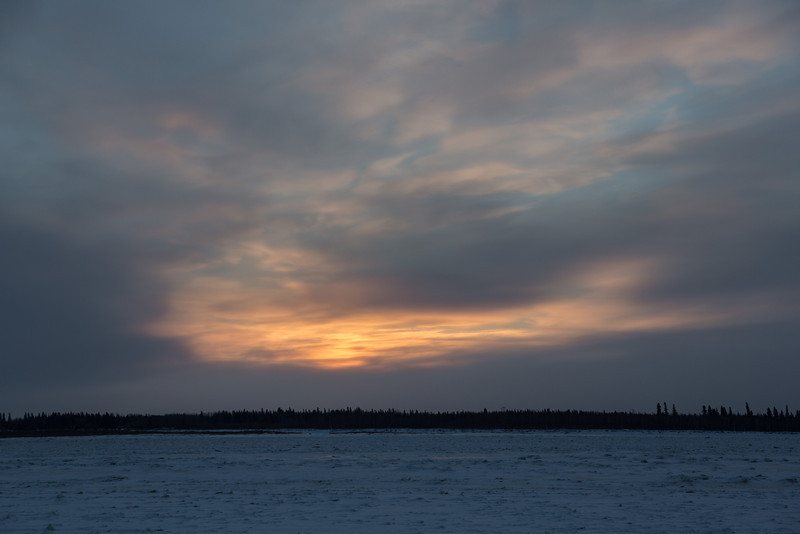 Sunrise at Moosonee over the Moose River. Cloudy and cold.