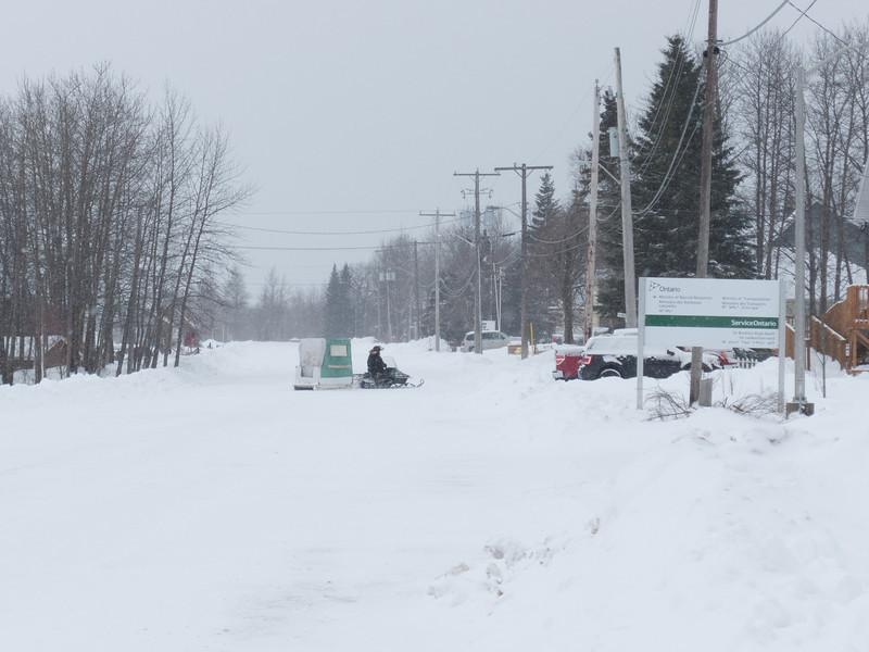 Revillon Road in light snow.