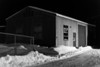 Shed at Ontario Government Building in Moosonee. Black and white.