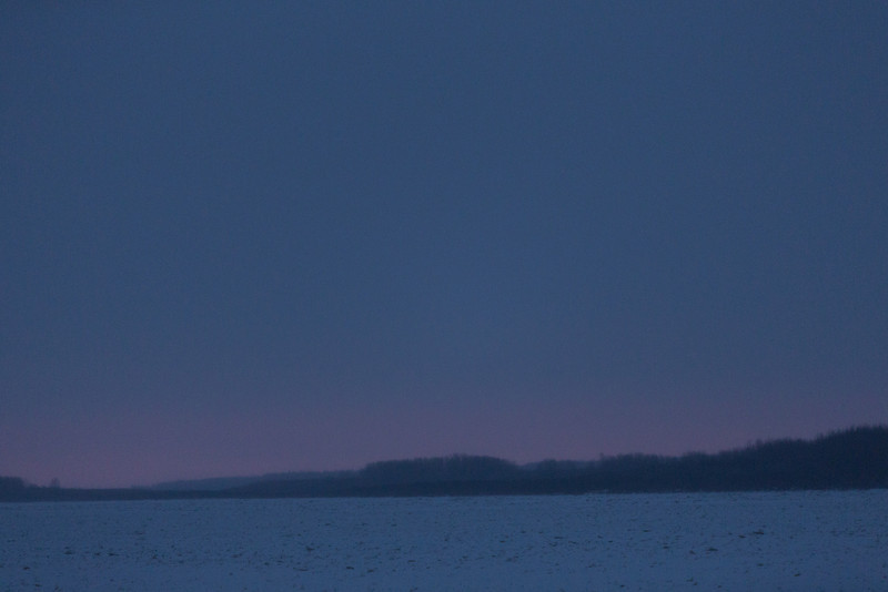 Looking down the Moose River to the only bright colour in the sky before sunrise at Moosonee.