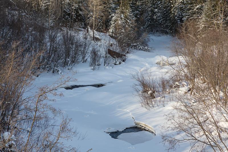 Store Creek looking towards dam up stream from railway bridge. Ice and water.