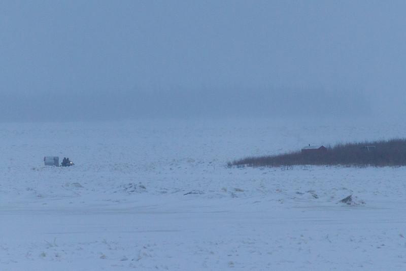 Snowmobile and sled approaching Bushy Island near Moosonee. 2013 December 12