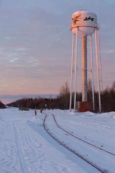 Moosonee former water tower lit up by sunrise.