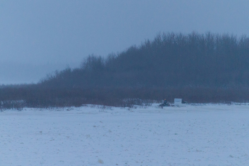 Snowmobile and sled in front of Bushy Island headed for Moose Factory.