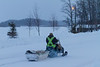Snowmobile with sled on Revillon Road in Moosonee.