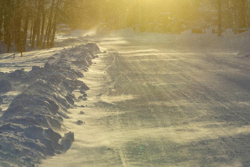 Revillon Road in blowing snow.