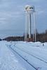 Moosonee's former water tower just before sunrise looking down tracks.