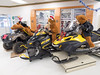 ATV and snowmobile display at Northern Store in Moosonee with large stuffed animals as riders.