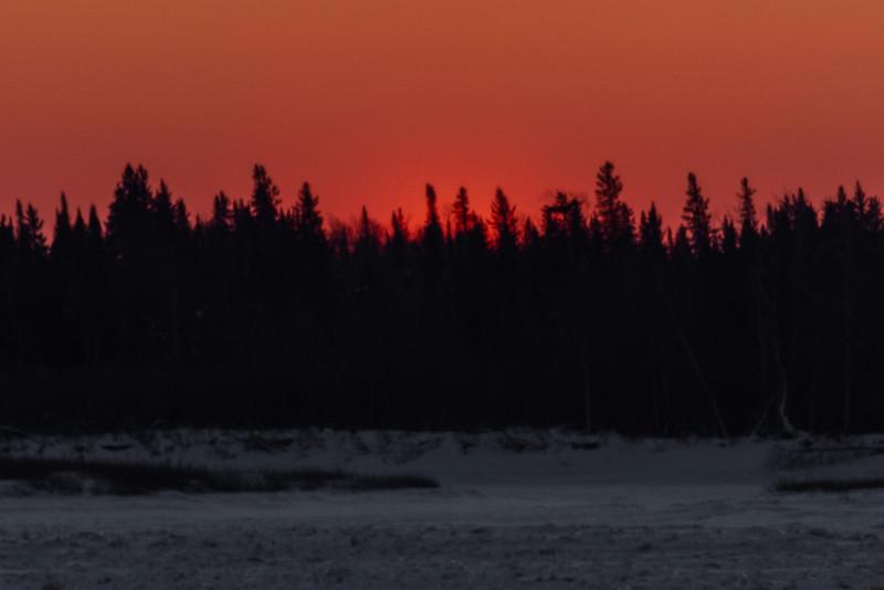 Sky across the Moose River from Moosonee just before sunrise.