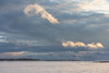 Looking up the Moose River from Moosonee. Blowing snow and fast clouds. View towards hydro towers.