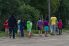 Children and counselors walking along Revillon Road.