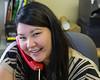 Kristen Linklater working at reception at Keewaytinok Native Legal Services.