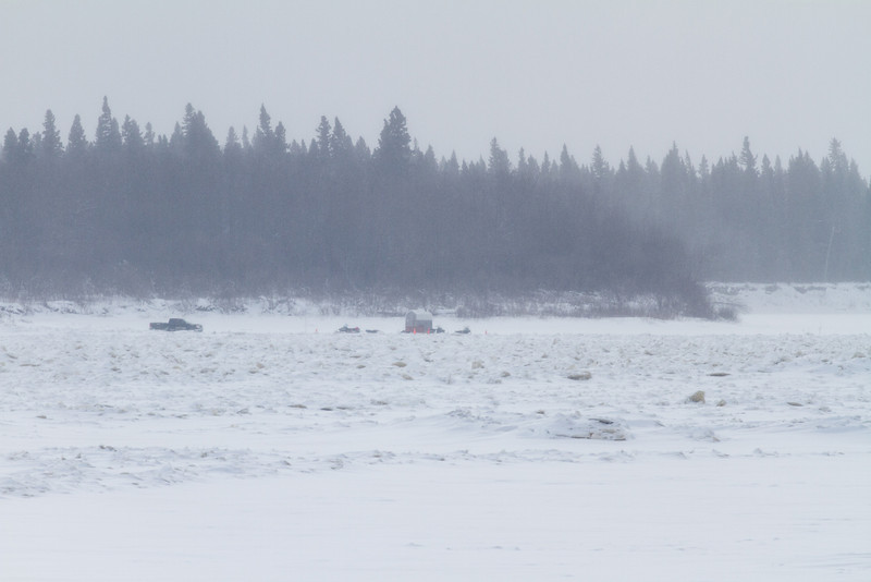 Truck, snowmobiles and shed near south end of Charles Island on the Moose River near Moosonee.