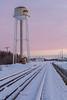 Looking towards Moosonee around sunrise from down tracks. Former water tower, purple sky.