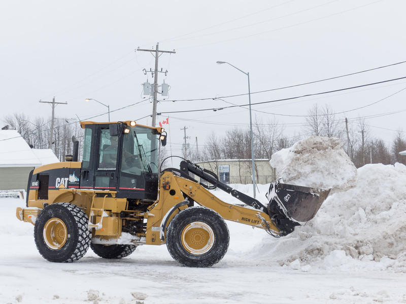 Snow removal in Northern Store parking lot.