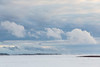 Looking up the Moose River from Moosonee. Blowing snow and fast clouds.  Looking towards hydro towards.