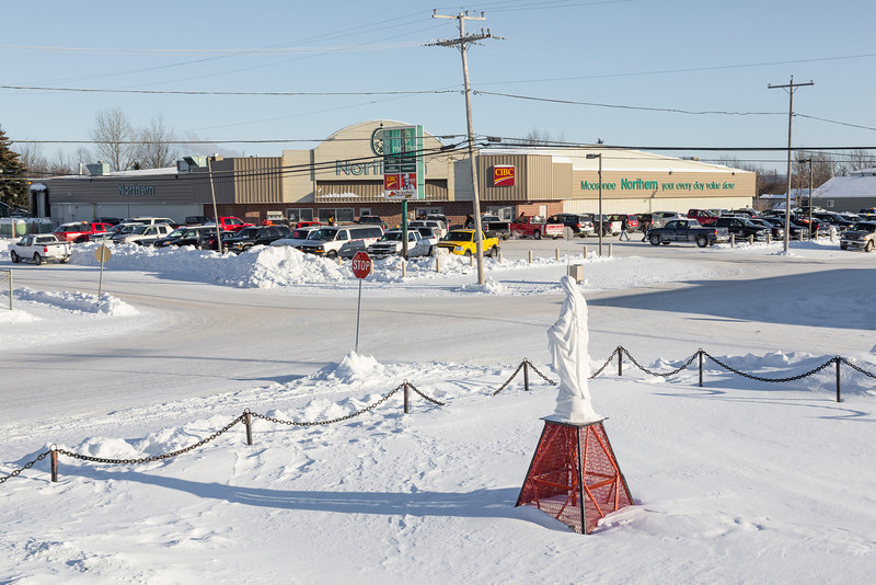 From the steps of the cathedral in Moosonee, view of Northern Store parking lot.