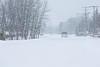 Traffic on Revillon Road in Moosonee during snow fall