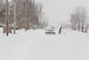 Snow shoveling on Revillon Road.