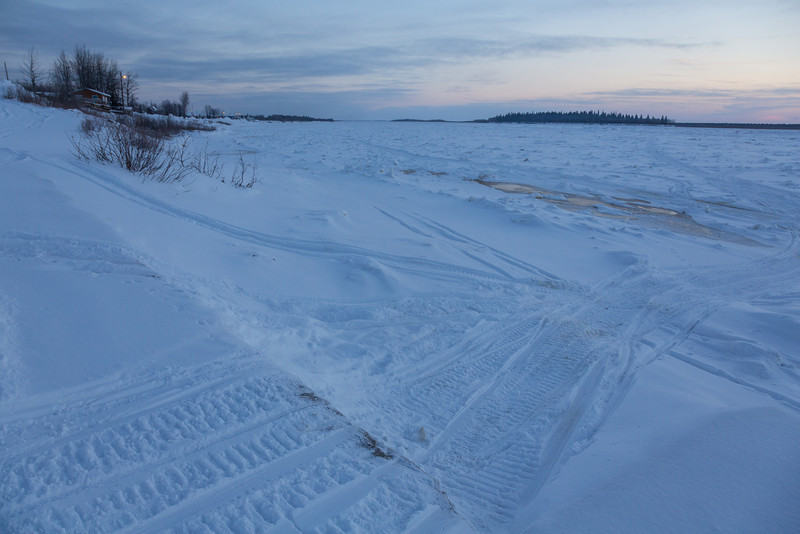 Moose River shoreline looking down river from public docks site.