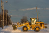 Snow removal on Revillon Road in Moosonee.