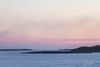 Looking up the Moose River towards hydro towers from Moosonee before sunset.