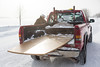 Moosonee's Mahikun Taxi takes old board room table to its new home in Moose Factory from Keewaytinok Native Legal Services.