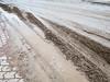 Mud along sidewalk on First Street.