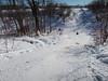 Looking across Store Creek in Moosonee. Creek bank used for sliding.