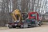 Putting Caterpillar 325L excavator onto float trailer.